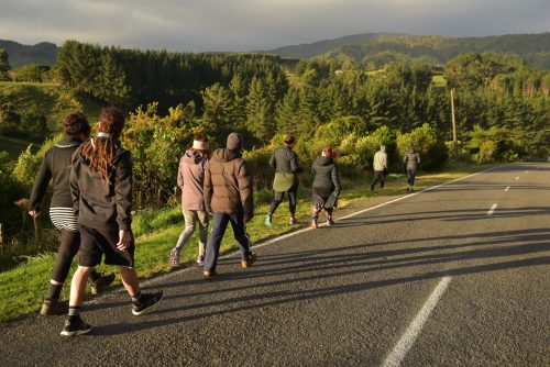 Image showing about ten people off for a hikoi (walk) down the road during the 2017 Flourishing Fellowship